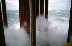 Rough Seas. Splash onto Well Cassions and lower deck on a Gulf of Mexico Production Platform Royalty Free Stock Photo