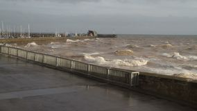 Rough seas at Bridlington with strong on shore winds. stock footage