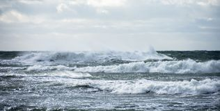 Rough seas, Dorset, UK. Waves and white water at high tide on a stormy winters day at Kimmeridge Bay, Dorset, UK Stock Image