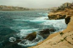 Rough seas at Marsaskala. Rough seas pounding the rocks at Marsaskala, Malta Royalty Free Stock Photography