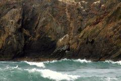Rough Seas and Oregon Coast. Steep rocky shoreline and rough waves highlight the wild Oregon Coast Stock Photo