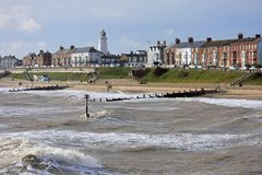 Rough Seas at Southwold, Suffolk, UK. Southwold, Suffolk, England - the sea-front and lighthouse in rough weather royalty free stock image