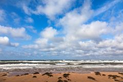 Rough seas at Thunder Cove Beach. Rough seas and big sky at Thunder Cove  Beach, Price Edward Island, Canada Stock Images