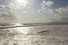 Rough seas in Versilia at sunset time Royalty Free Stock Photography