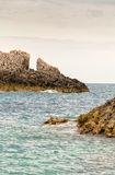 Rough seaside rocks in Greece Royalty Free Stock Photo
