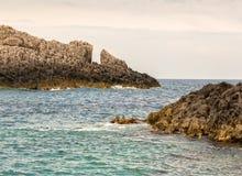 Rough seaside rocks in Greece Royalty Free Stock Photos