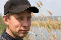 The rough sexual macho. The rough sexual unshaven macho with a cigarette Stock Images