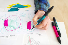 Rough Sketch. Left handed designer making a rough sketch of a system solution during the product design process stock photos