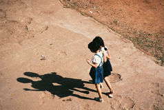 Rough skipping. Two girls skipping on broken playground after school in Vietnam Stock Photo