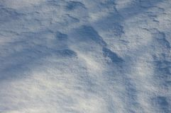 Rough snow surface with deep shadows. Winter ground texture looking like landscape. Abstract white and blue background Royalty Free Stock Photography