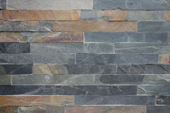 Rough stone cladding tiled wall Stock Photos