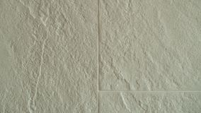 Surface of rough stone tiles, wall textured stock image