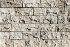 Rough stone wall. Texture of a rough stone wall made with blocks Royalty Free Stock Photo