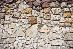 Rough stone wall. Details of a handmade, stone wall Royalty Free Stock Photography