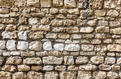 Rough stone wall as creative background texture stock images