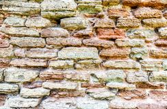 Rough stone wall as creative background texture royalty free stock photography