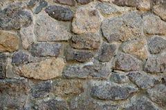 Rough stone wall background Stock Photos