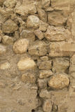 Rough stone wall background. Closeup of a rough building stone wall royalty free stock photos