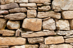 Of rough stone wall of big and small rocks Stock Image