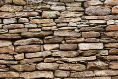 Of rough stone wall of big and small rocks Stock Photos