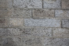 Rough stone wall texture. Grunge sandstone brick wall background Royalty Free Stock Image