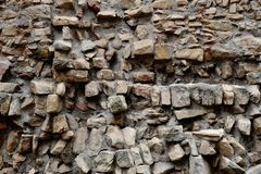 Rough stone wall. Very rough brown stone wall Royalty Free Stock Photo