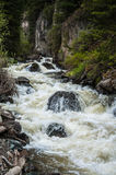 Rough stormy river in rocky mountains Stock Photo