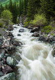 Rough stormy river in rocky mountains Stock Photos