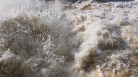 Rough stream. Of water discharge at a dam stock video footage