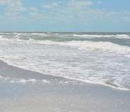 Rough surf at Indian Rocks Beach on the Gulf of Mexico in Florida. Stock Images