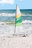 Rough Surf With Sailboat Stock Image