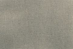 Rough surface fabric or textile material of monochrome dirty color Stock Image