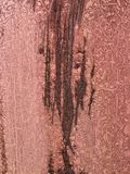 Red metal surface peeling paint and rust texture. Rough surface of metal plate..The red paint is glued royalty free stock images