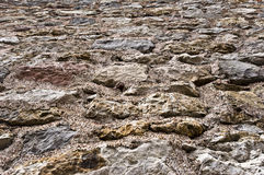 Rough surface of stones on the ground or on the wall. Stock Photography
