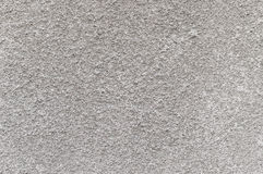 Rough texture of gray plaster. On a wall, cement, putty Stock Photography