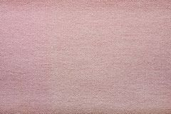 Rough texture of a pink textile material Royalty Free Stock Photos
