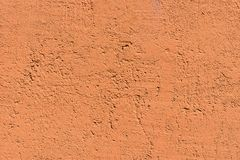 Rough texture plastered surface of orange color Stock Photography
