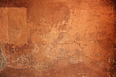 Rough textured brown cement wall Royalty Free Stock Images