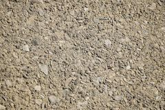ROUGH TEXTURED CLOSEUP OF CONCRETE. A closeup of a section of concrete shows the detail of the rocks embeded in it stock photo