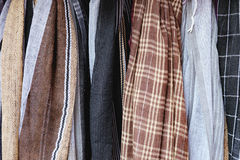 Rough textured fabric and textiles. Of pastel colors and checkered pattern for sale in the most famous market in Chinatown district, Bangkok, Thailand Stock Photo
