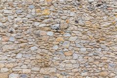 Rough textured old stone block wall Royalty Free Stock Photo