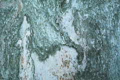 Rough textured stone surface. Abstract background of a rough textured stone with a grey mottled pitted surface Royalty Free Stock Photos