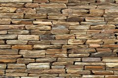 Rough textured wall created using flat rocks royalty free stock photo