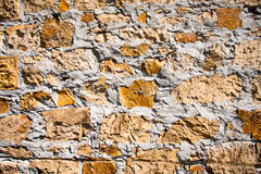 Rough textured wall made of bricks, stones, concrete Royalty Free Stock Photos