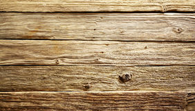 Rough textured weathered wood background. Old rustic rough textured weathered wood table or boards background viewed close up from above, full frame Stock Photos