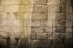 Sunlit Stone Wall Background. Rough textured yellow stone wall (from the famous 'Jerusalem Stone'), sunlit bu high-noon sun. Shot at the old city of Jerusalem Royalty Free Stock Images