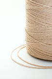 Rough thread. Coil of rough thread on white background stock image