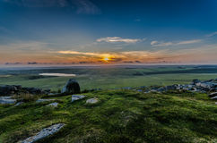 Rough Tor Sunset. Granite tor in Bodmin moor, cornwall, southwest england, uk Royalty Free Stock Image
