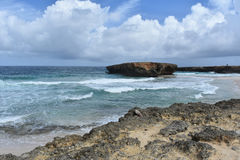 Rough Tropical Waters Off the East Coast of Aruba. Aruba`s Boca Keto deserted beach off the east coast of Aruba stock photography