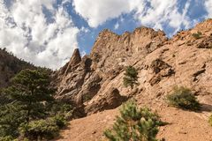 Rough and tumble mountain with cloudy sky. A rough and dry section of Seven Falls in Colorado Springs, Colorado Stock Images